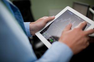 Businessman-checking-stock-market-on-tablet